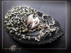 """""""Angel of the Tree of Life"""" Cold porcelain and acrylic colors, 6.3"""" width 9.5"""" height 2.4"""" depth"""